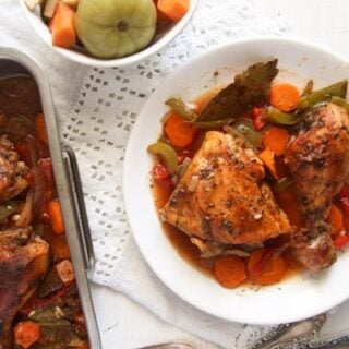 Romanian chicken dish with vegetables served with pickles