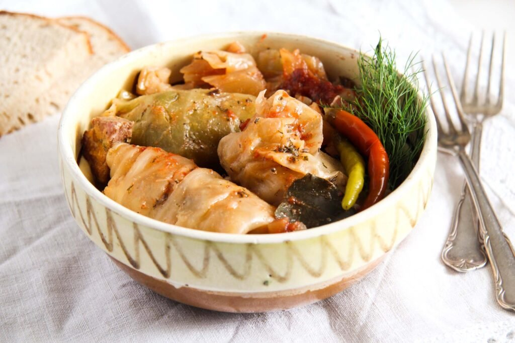 stuffed cabbage in a earthen dish.