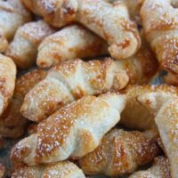 croissants with jam sprinkled with icing sugar close up