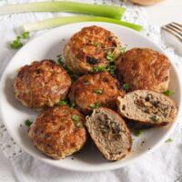 mushroom stuffed meatballs served on a small white plate