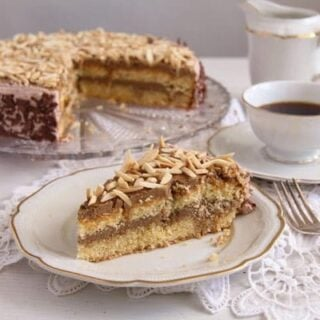 polish coffee cake with almonds and coffee in a vintage cup