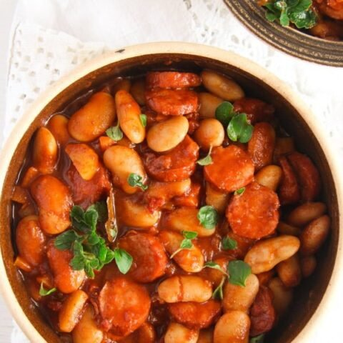 pot with bean stew and sausages