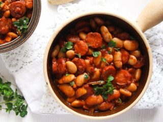 cabanossi sausage stew with poatoes and beans in a pot