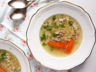 plate with rosol polish soup with noodles