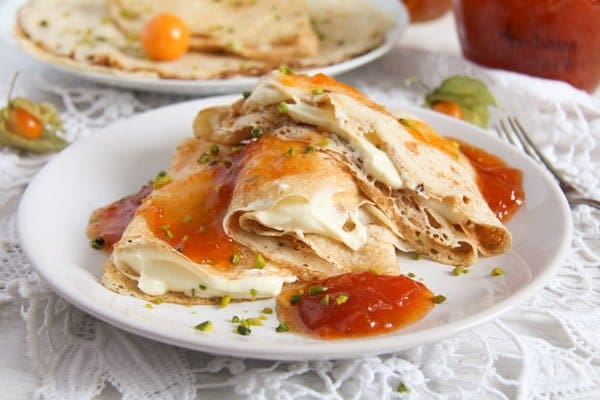 polish crepes nalesniki filled with sweet cheese and topped with apricot jam
