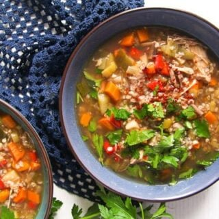 blue bowel full of buckwheat soup with vegetables and parsley on top