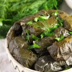 rustic bowl full with vegetarian dolmades stuffed with rice