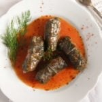 stuffed grape leaves with meat and rice in tomato sauce