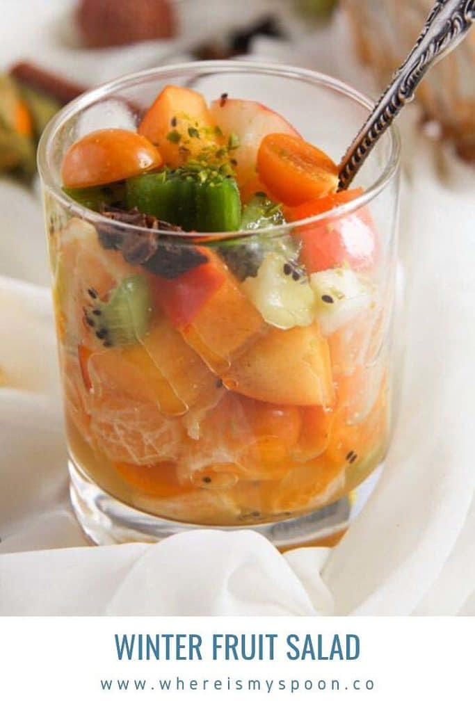 winter fruit salad with sugar syrup dressing in a glass