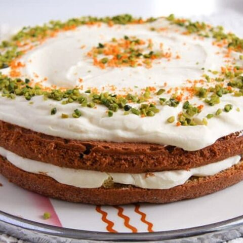 almond, orange and carrot cake on a vintage platter