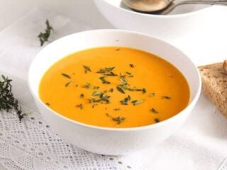 creamy carrot soup with milk in a bowl
