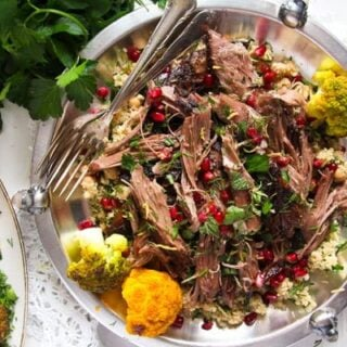 shoulder of lamb shredded on a plate overhead view.