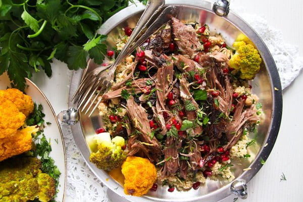plate of pulled lamb with pomegranate
