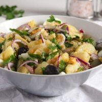 gherkin potato salad with eggs in a blue vintage bowl