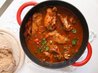 rabbit stew with lots of sauce in a pot