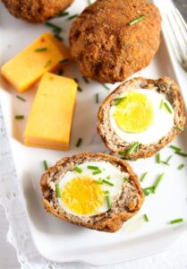 scotch eggs recipe 8 209x300 Classic Scotch Eggs Recipe – Fried, with Sausage and Herbs