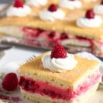 raspberry lemon curd cake cut into squares and served on vintage plates