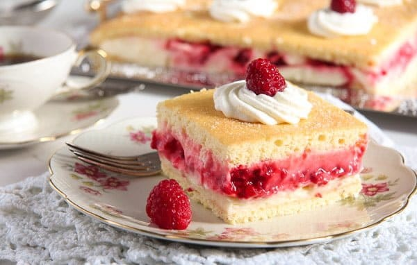 lemon cake with curd and raspberries