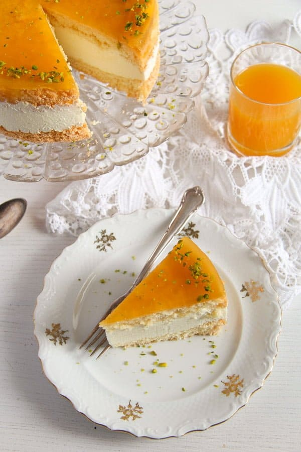 cheesecake maracuya sliced on a small vintage plate