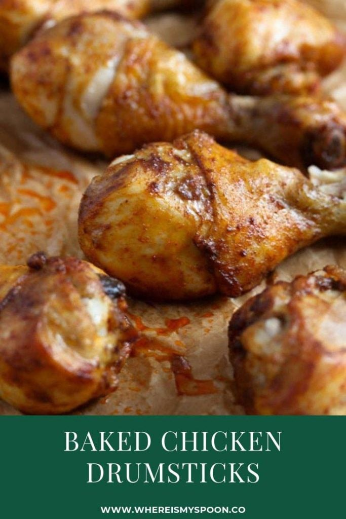 oven baked chicken drumsticks on a baking tray