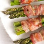 green asparagus bundles wrapped with bacon slices