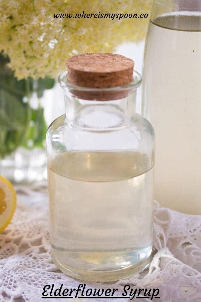 corked bottle of elderflower syrup