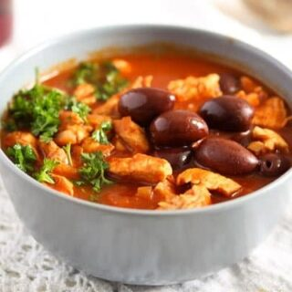 moroccan chicken stew with olives and ras-el-hanout in a bowl