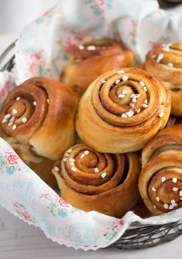Swedish cinnamon rolls in a small basket