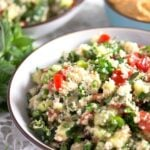 mediterranean parsley salad served with hummus