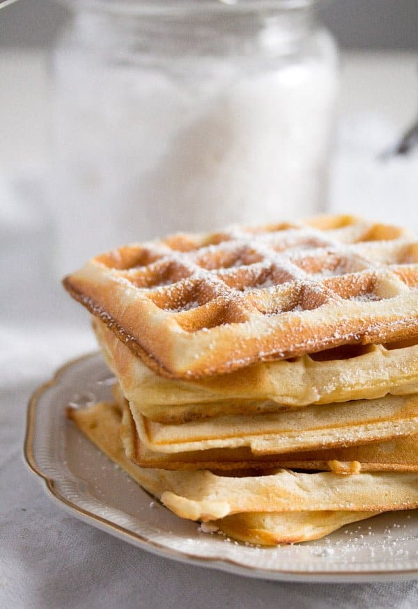stack of Belgian waffles with powder sugar