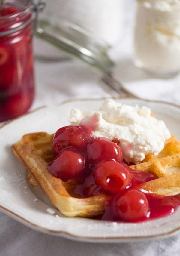 Belgian waffle with cherry sauce