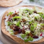 tostada recipe with chorizo,beans and cheese.