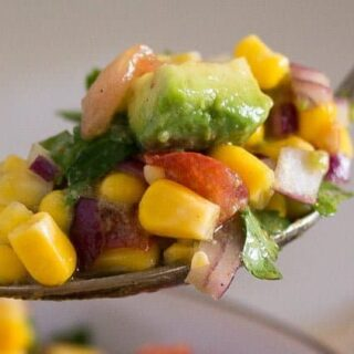 corn avocado salad on a spoon close up