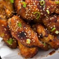 korean chicken wings with gochujang wing sauce on a plate