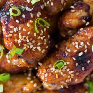 oven baked korean chicken wings sprinkled with green onions and sesame seeds