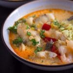two bowl with moqueca stew with prawns and cod