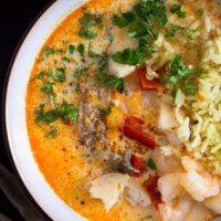 full bowl of moqueca de peixe with brazilian rice
