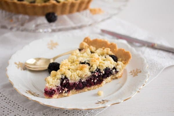 slice of blackberry pie with crumble topping
