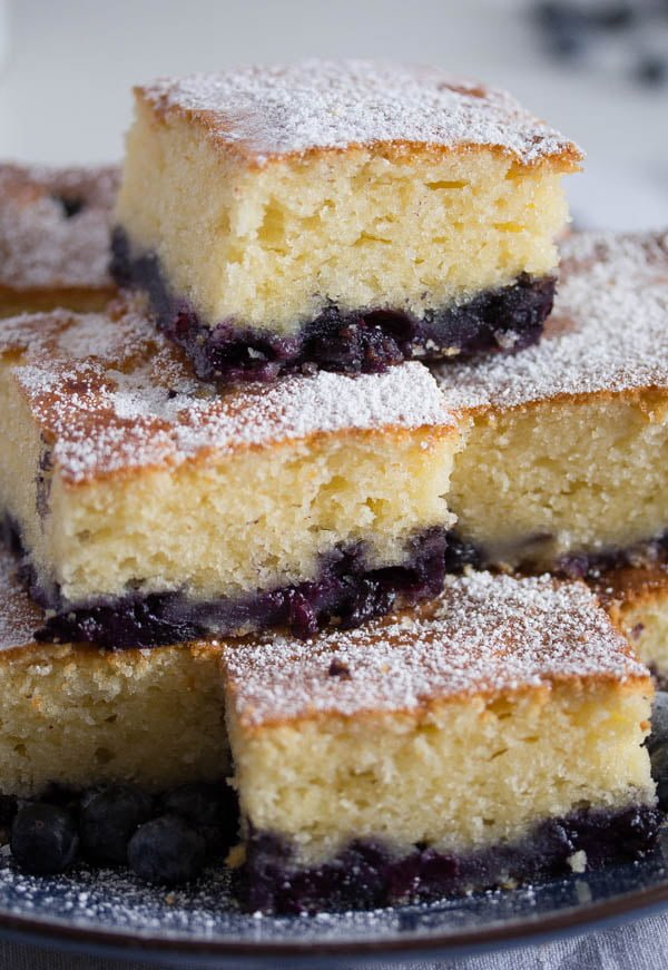 slices of sour cream cake with blueberries