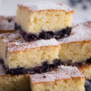 stapled squares of lemon blueberry cake with sour cream