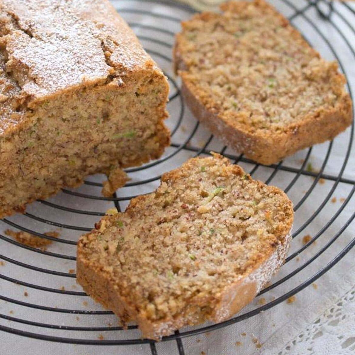 cinnamon zucchini bread sliced on a cooling rack