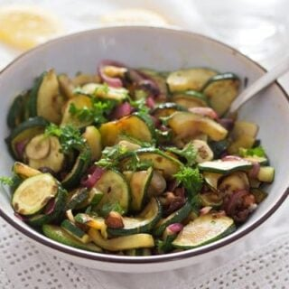 bowl of sauteed zucchini and onions