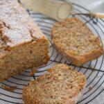 sliced courgette loaf cake on a rack