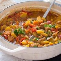 Hungarian pork stew in a white pot