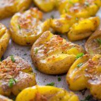vegan smashed potatoes with garlic on a baking tray