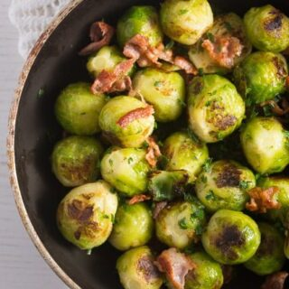 close up pan roasted brussels sprouts with bacon and garlic