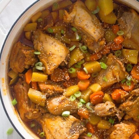 pot with chicken pieces, potatoes and carrots