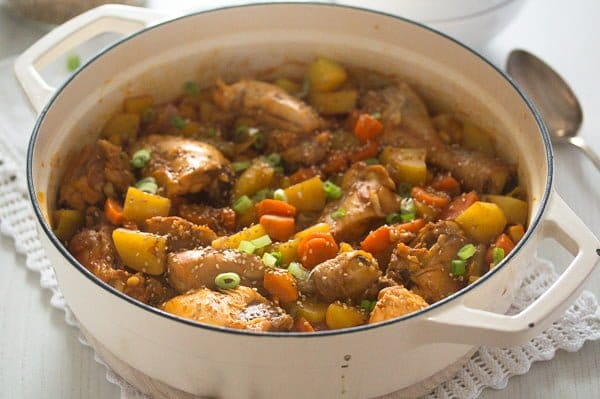 asian chicken stew with potatoes in a large white pot