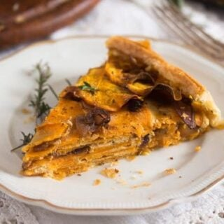 slice of sweet potato puff pastry pie on a vintage plate