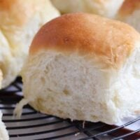 soft yeast rolls on a wire rack